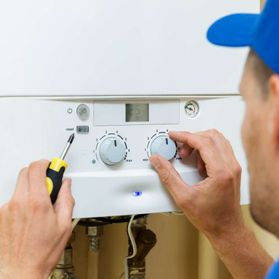 A plumber working on a boiler