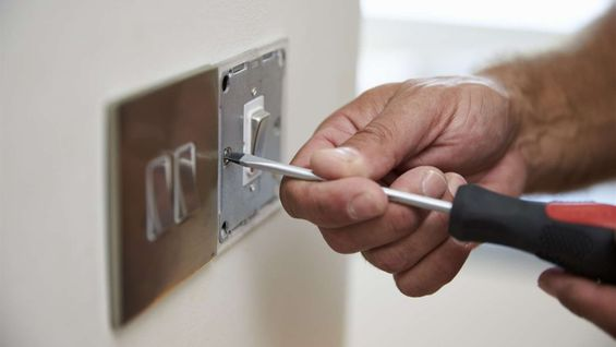 A light switch being wired up